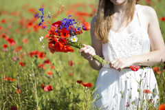 Woman at white dress with zoomed bouquet Royalty Free Stock Image