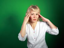 The woman in a white dressing with a headache Stock Photo