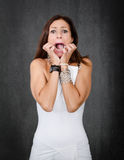 Woman in white fear and scream Stock Images