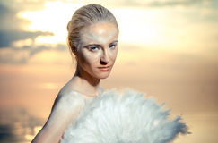Woman with white feathers fan Royalty Free Stock Image
