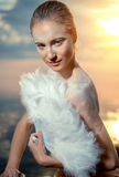 Woman with white feathers fan Royalty Free Stock Photography