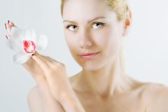 Woman with white flower Stock Photography