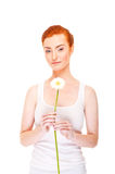 Woman with white flower near her face on white background Stock Photo