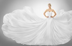 Woman White Flying Dress, Elegant Fashion Model Posing in Gown. Woman White Flying Dress, Elegant Fashion Model Posing in Wedding Fluttering Gown, Bride Art Royalty Free Stock Images