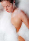 Woman and white foam. Portrait of a beautiful woman in white foam Royalty Free Stock Photo