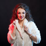 Woman in white fur on black background Royalty Free Stock Photography