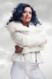 Woman in white fur coat Stock Photography