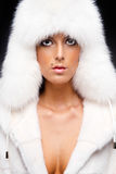Woman in white fur coat and cap Royalty Free Stock Photos