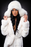 Woman in white fur coat and hat Stock Photo