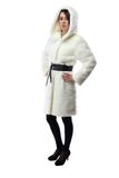 Woman in white fur coat with hood, half turned Stock Photo