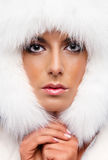 Woman in white fur hat Stock Photos