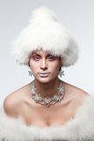 Woman in white fur hat. Beautiful woman in white fur hat with frost on lips royalty free stock photos