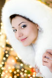Woman in white fur hood Royalty Free Stock Photography
