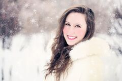 Woman in White Furred Jacket Smiling in Front Royalty Free Stock Images