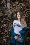 Woman in White Girl Can Do Anything-printed Crew-neck Shirt royalty free stock image