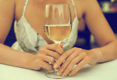 Woman with white glass of wine. Royalty Free Stock Image