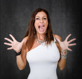 Woman in white go crazy and scream Stock Photo
