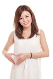 Woman in white with hands in shape of a heart Stock Image