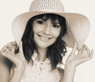 Woman in white hat. Romantic portrait of young woman in white hat Royalty Free Stock Photography