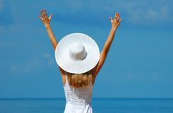 Woman in a white hat stock images