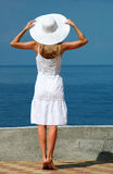 Woman in a white hat. The woman in a white hat with the lifted hands Royalty Free Stock Images