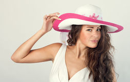 Woman in a white hat Royalty Free Stock Image