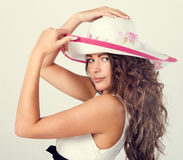 Woman in a white hat Royalty Free Stock Photography