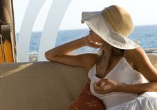 Woman in white with hat Royalty Free Stock Images