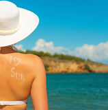 Woman in white hat against sea. Stock Photo