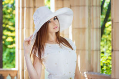 Woman in white hat Royalty Free Stock Image