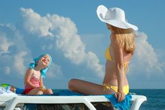 Woman in a white hat and the child Stock Photography