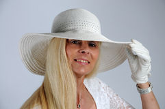 Woman with white hat Royalty Free Stock Photography