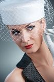 Woman in white hat with net veil Stock Photography