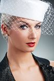 Woman in white hat with net veil Royalty Free Stock Photo