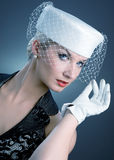 Woman in white hat with net veil Royalty Free Stock Photos