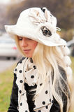 Woman in white hat Stock Photography