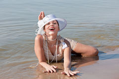 Woman in white hat posing against the sea Royalty Free Stock Photo