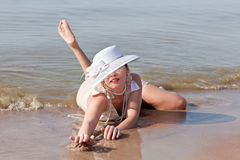 Woman in white hat posing against the sea Stock Images