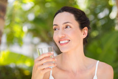 woman in white having a glass of water Stock Photo