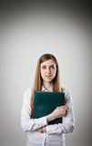 Woman in white is holding a folder. Stock Photos