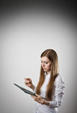 Woman in white is holding a folder. Stock Photo