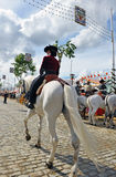Woman on white horse at the fair in Seville, Andalusia, Spain Stock Image