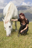 Woman with white horse Royalty Free Stock Images