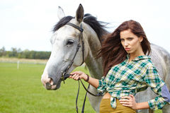 Woman with a white horse Royalty Free Stock Photography