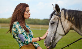 Woman with a white horse Stock Photography