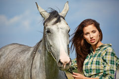 Woman with a white horse Royalty Free Stock Image