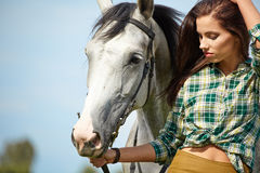 Woman with a white horse Stock Image