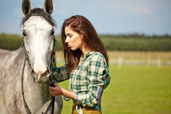 Woman with a white horse Royalty Free Stock Photo