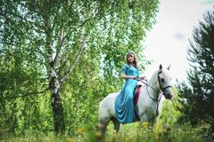 Woman in White Horse Inside Forest Stock Photography