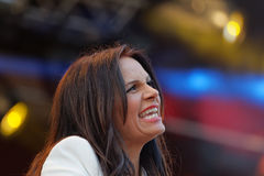 Woman in white jacket singing Royalty Free Stock Images